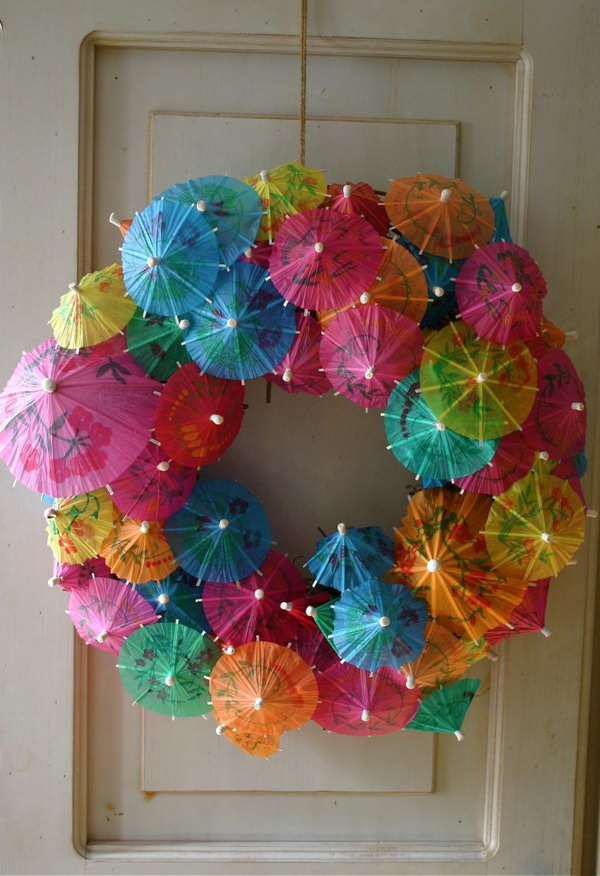 Paper Umbrella Wreath. Paper cocktail parasols or umbrellas are available at party supply stores. You can collect them and make this craft. It looks so wonderful in your kids' door.