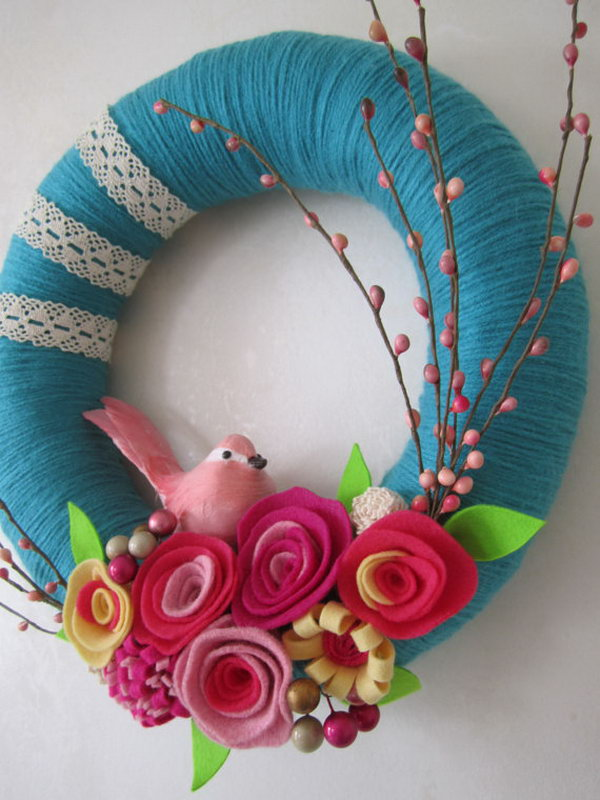 Pink Bird Teal Yarn Wreath. This bird teal yarn wreath is super beautiful and adorable. It is the favorite of most girls. It is a perfect decor of your daughter' room.
