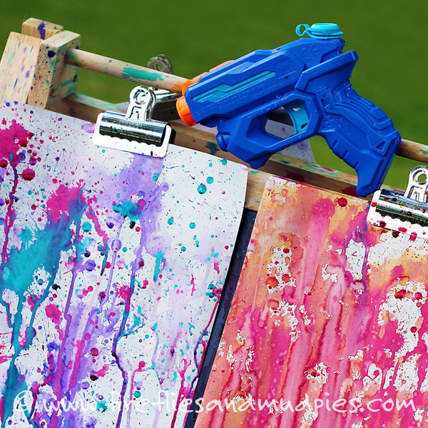 Squirt gun painting. This fun art project is such an awesome summer activity- Hang up a few white sheets on a line. Fill up water guns with different water colors and let the kids make their masterpiece.