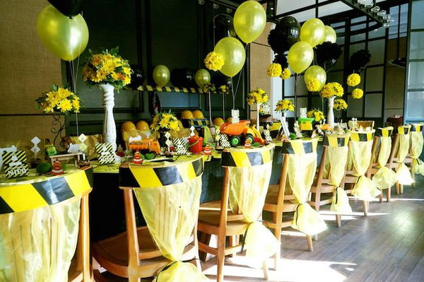Construction Party Decoration: Look at the awesome construction sign chair ties and the yellow and black balloons, they are so fitting and fun for the construction theme.