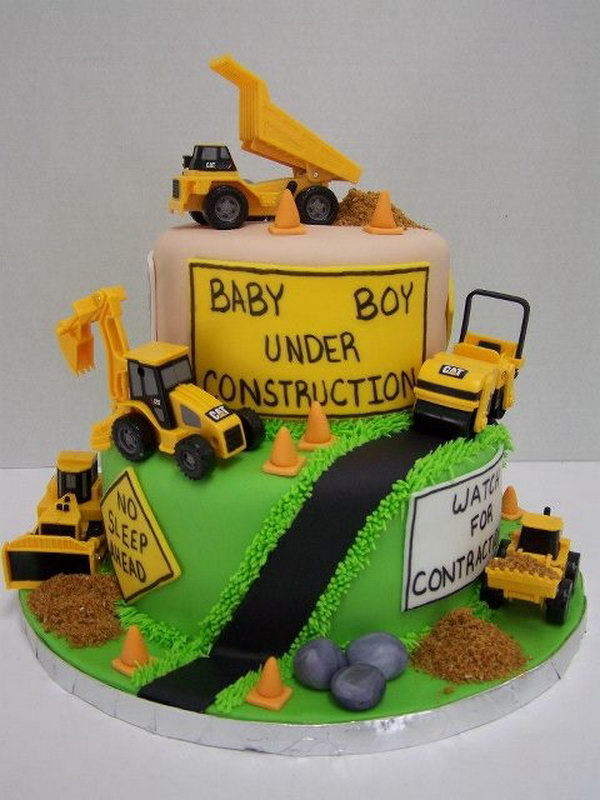 Cute Construction Cake: It's hard to imagine a little tractor lover not in fond of this beautiful cake with lots of trucks around.