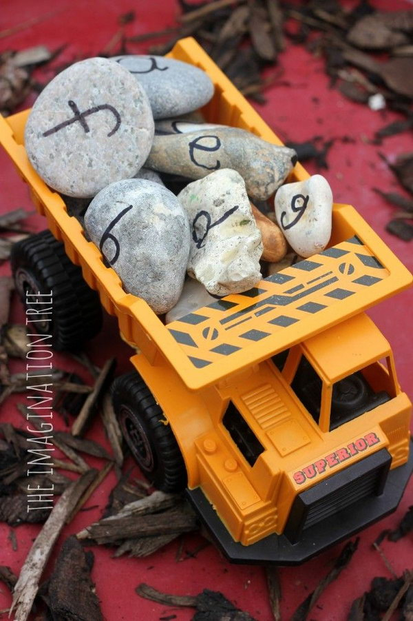 Truck Themed Birthday Party Activity: Learn the alphabet and practise spelling words using alphabet rocks in a construction site play activity! Lots of hands on fun and literacy learning for kids.
