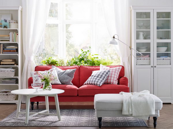 Red & White Living Room. Red is always related with passion. In this living room, the red sofa from IKEA adds more inviting and hospital feeling to this calm and classic white living space. The sofa is placed beside the window and the bookcase. You can enjoy the sunlight when do some reading here.