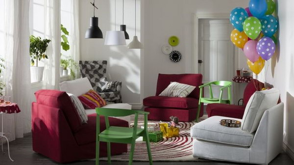 Living Room Cheered Up by Colors.  Bring some brightness into your small living room with colorful accent furniture and accessories. Look at this example from IKEA. The red sofas, green chairs and colorful balloons, rainbow throws really pop up this small living space.