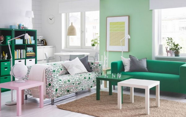 Living Room for Green Lovers. Here green is used in nearly a shocking fashion. Green book shelves, green sofas , green side table and light green painted-wall are featured in this living space. If you are a green lover, you can get some inspiration from this decor.