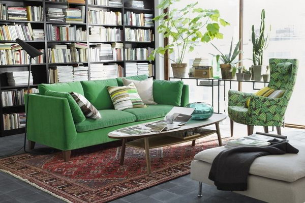 A Living Room Inspired by Nature. Loving the organic color schemes in this living room.  A comfy green sofa, leaf print chair and plenty of plants add a warm and homey feeling to this space.
