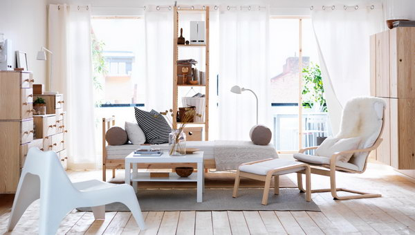 Natural & Restful. In this living room, the combination of natural wood and a neutral color palette creates a welcoming and calming atmosphere for both the family members and visitors.
