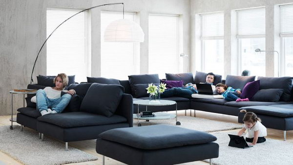 It's so simple but nice. In this big living room, everyone can have his own place and be alone but together too. Especially love the sofa and the big pendant lamp which are super functional and has an industrial cool. They also make this living space  look more cozy and not so empty.