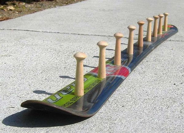 DIY Skateboard Coat Rack: For your coats, you can design a skateboard coat rack that is just for you. To make one, you need to drill some holes and get yourself some hooks!