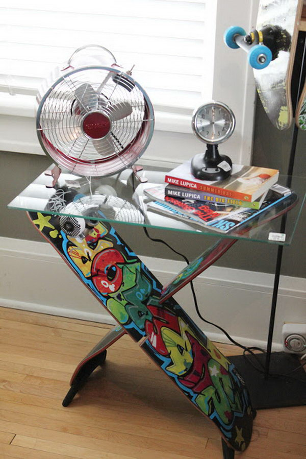 Skateboard Table: This is an cool skateboard furniture that is suitable for a side table for a teenage boy's bedroom or playroom. Very impressive and striking.