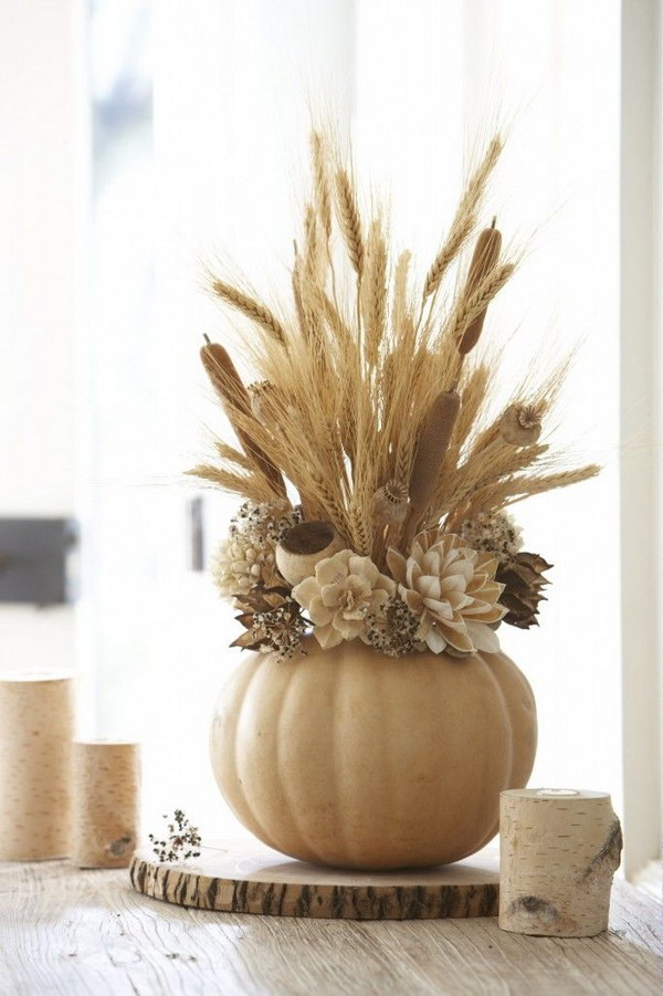 Fall Harvest Arrangement. Use faux pumpkins to create stunning centerpiece arrangements.