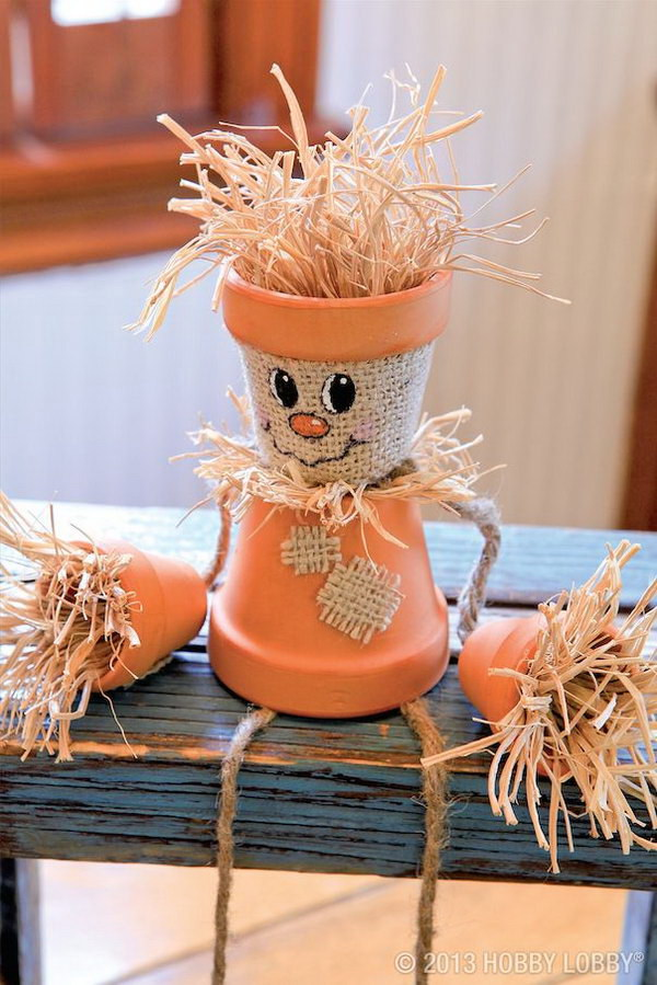 Turn Flower Pots Into Scarecrows.