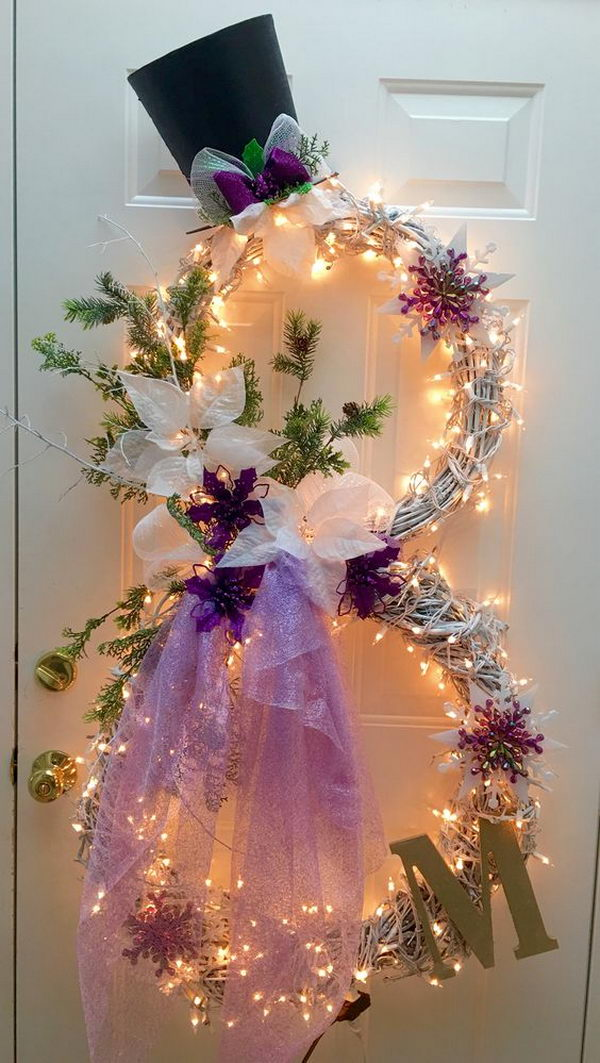 create a lighted snowman wreath using 2 grapevine wreaths