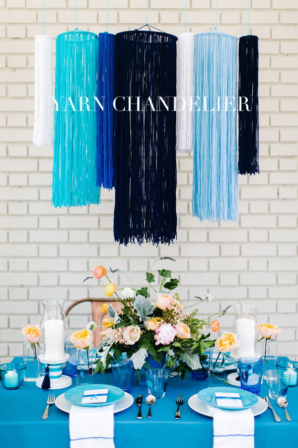 Gorgeous Yarn Chandelier Tutorial. Doesn't this yarn chandelier look striking and romantic? I'd like this for my shabby chic dining room. Tutorial via