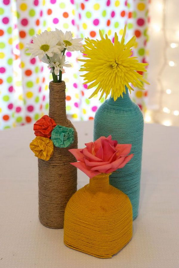 DIY Yarn Wrapped Wine Bottles. Completely easy way to update the look of all those wine bottles and get an expensive look for centerpieces! See the full tutorial on