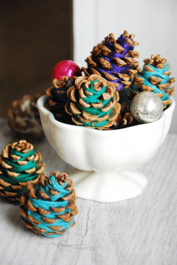 DIY Colorful Yarn Wrapped Pinecones. The fall is just around the corner and it's time to decorate with pinecones and leaves. And this is a good idea to add a pop and keep the rustic look. Tutorial via