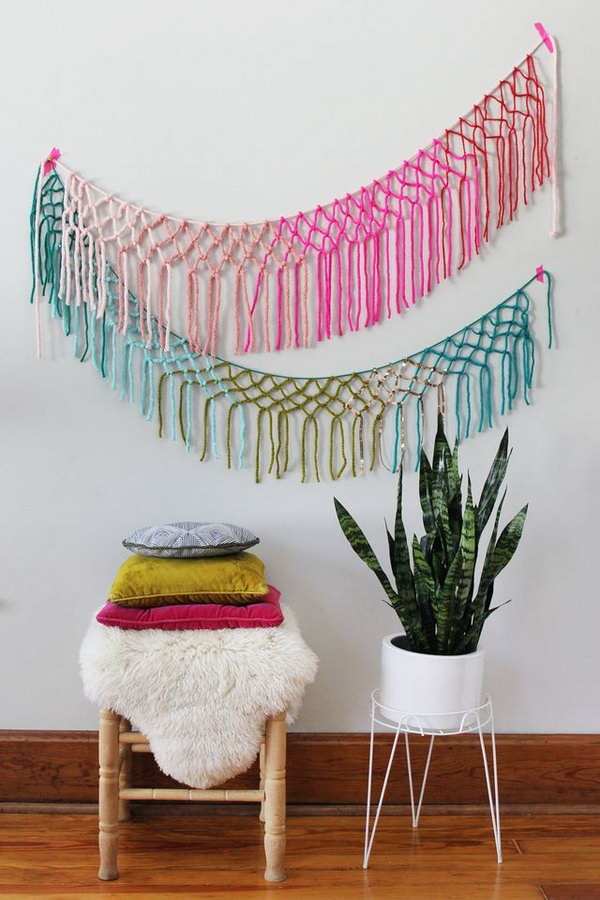 DIY Macrame Yarn Garland. This is really a great yarn banner wall decor idea for festival, party, and wedding. Tutorial via