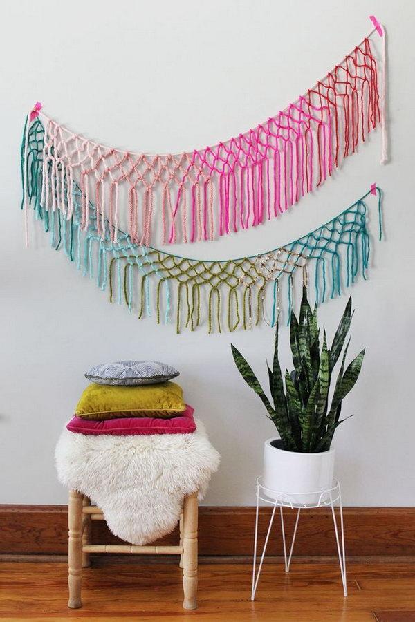DIY Macrame Yarn Garland. This is really a great yarn banner wall decor idea for festival, party, and wedding. Tutorial via