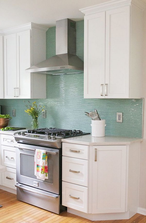 Snow White Cabinets Paired With Turquoise Backsplash