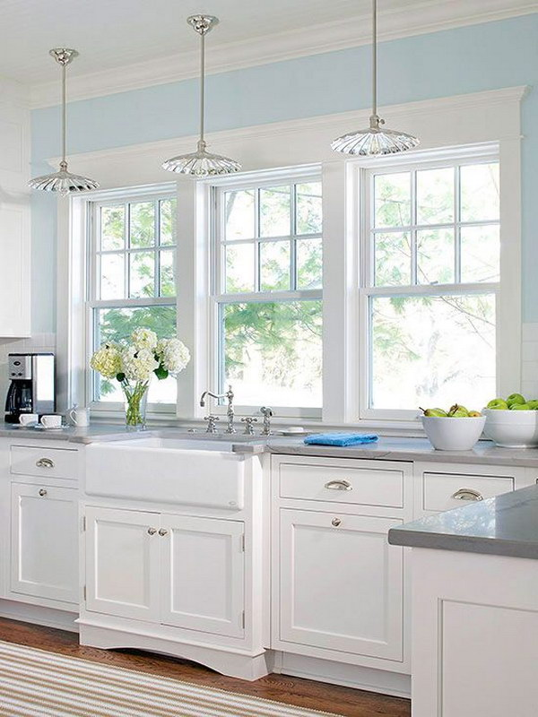 Bright White Kitchen With Large Windows.