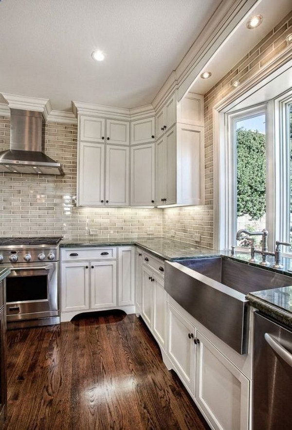 Off-White Kitchen Cabinets with Brick Backsplash.