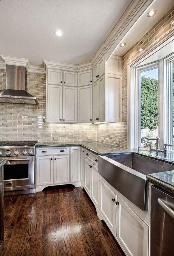 Off-White Kitchen Cabinets with Brick Backsplash.