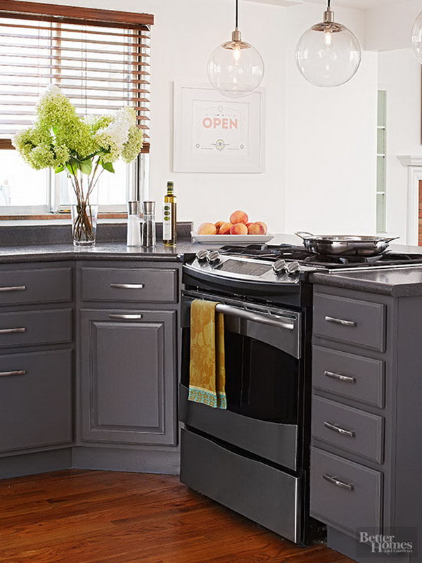 Slate Gray Cabinets with Crisp White Walls and Sleek Silver Finishes.