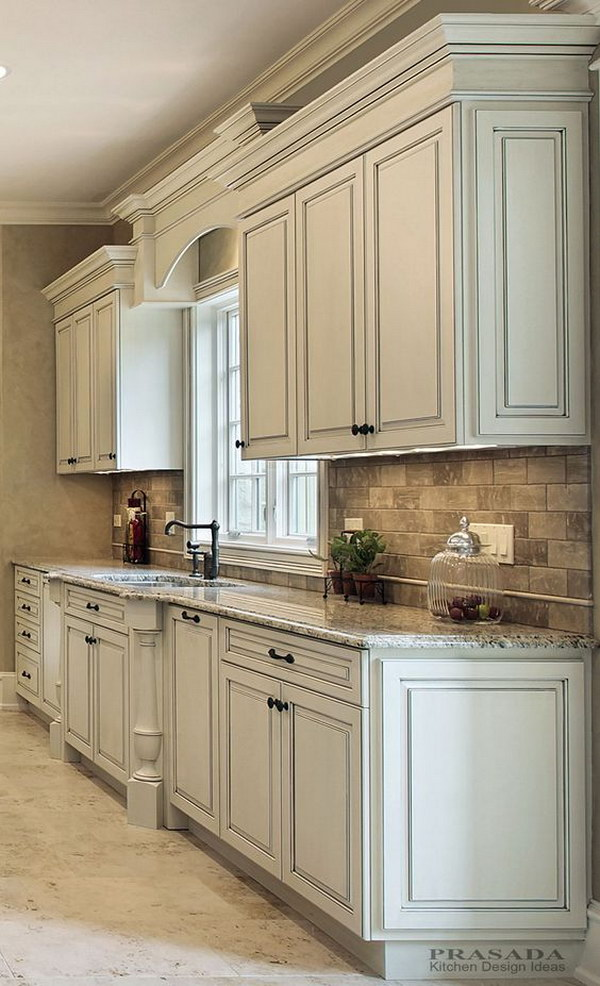 Kitchen Cabinet Paint Colors Antique White Cabinets with Clipped Corners on the Bump Out Sink, Granite  Countertop, Arched Valance