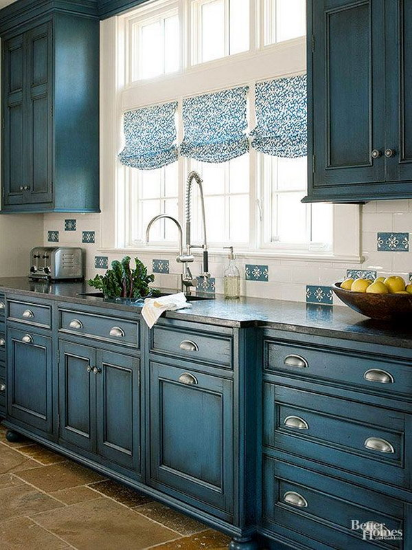 Navy Blue Kitchen Cabinet with Silver Hardware.