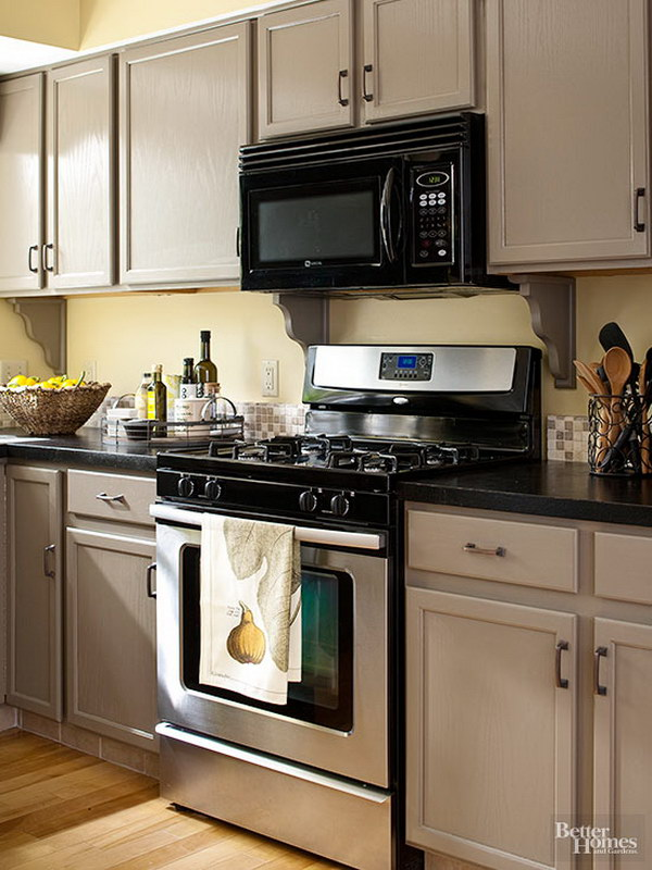 An Inviting Blend of Brown and Gray Kitchen Cabinet Paint Color.