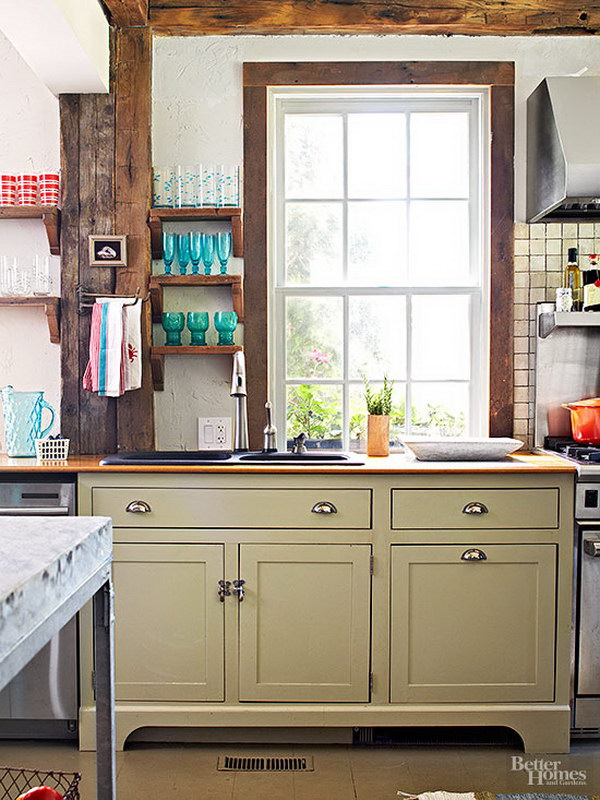 Sage Green Painted Cabinets with Rustic Elements for a Kitchen.