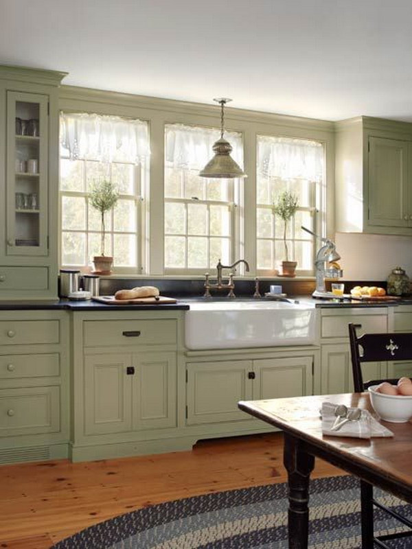 Grey-green Cabinets Paired with Apron Sink and Double Hung Windows.