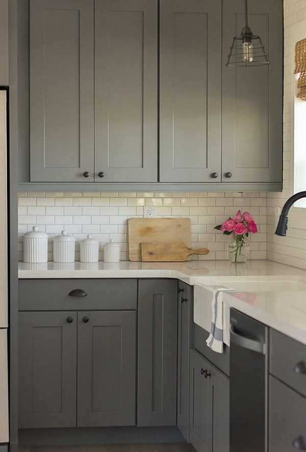 Gray Kitchen Cabinets with White Subway Tile Backsplash.
