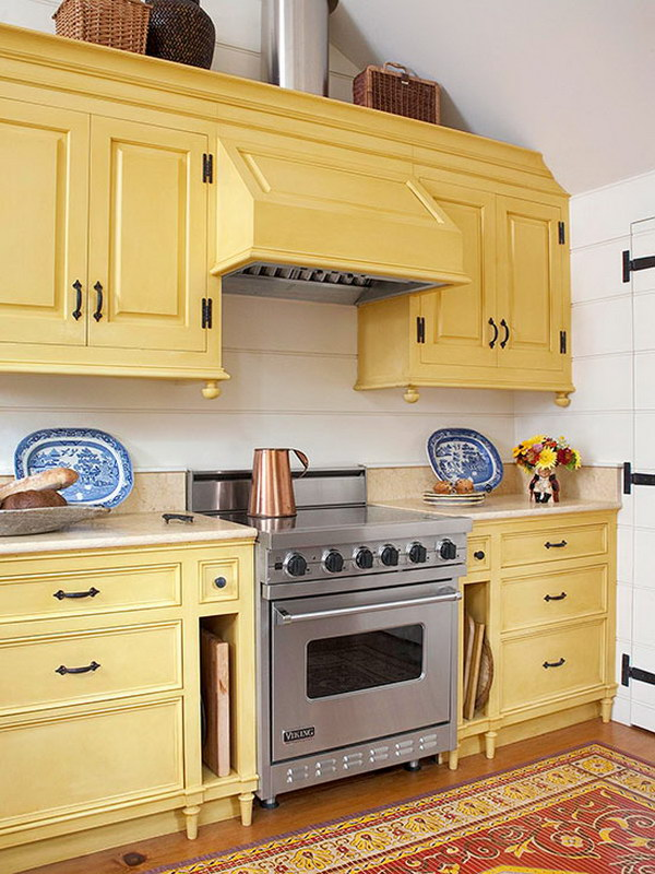 White Kitchen With Yellow Cabinets.