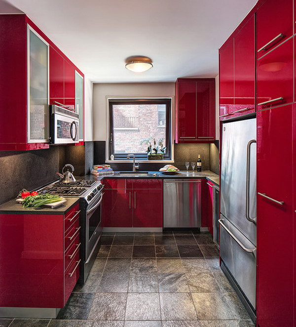 Contemporary U-shaped Enclosed Kitchen with Flat-panel Red Cabinets.