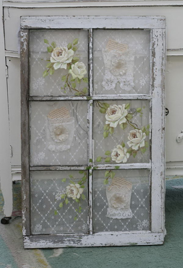 Old Window with Vintage Lace Behind the Panes and Roses Painted on the Glass.