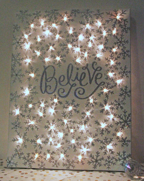 DIY Illuminated Canvas using  Sharpies and String Lights .