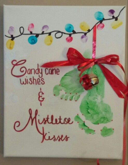 Christmas Canvas Using Footprints for Ornaments and Thumbprints for Lights.