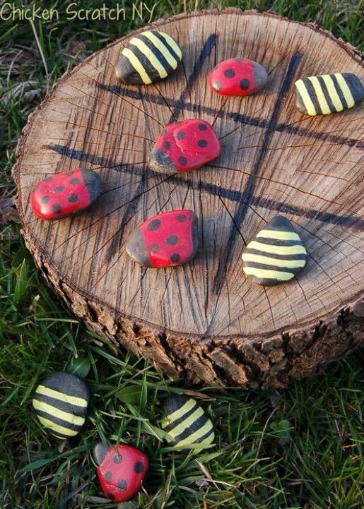 Use A Tree Stump And Some Stones To Create A Tic-Tac-Toe Game Board.