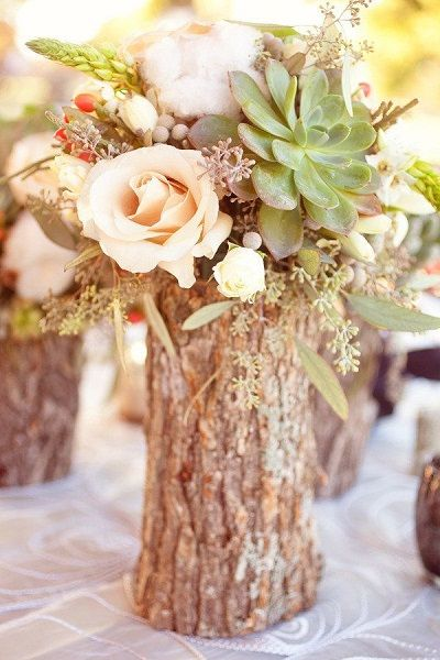 Tree Stump Vases Filled With Flowers As Fall Wedding Centerpiece.