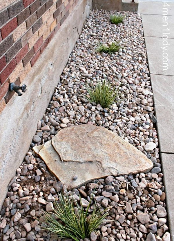 Use A Large Rock To Prevent Erosion From The Outdoor Spigot.