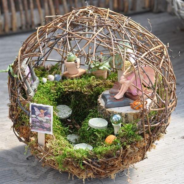 diy fairy garden inside a small grapevine sphere